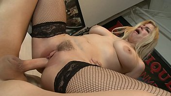 Busty blonde in fishnets on high heels riding meaty dick