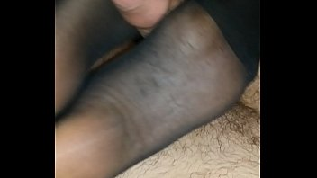 homemade footjob with black pantyhose and cumshot