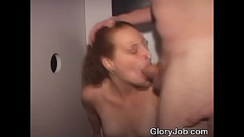 Brunette Amateur On Her Knees Sucking Dicks At A Glory Hole