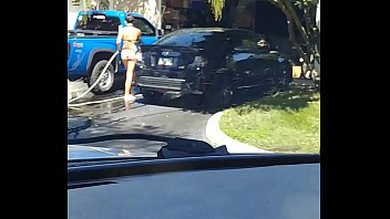 Sexy teen washing car in 2 piece bikini