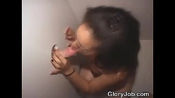 Brunette Amateur On Her Knees Sucking Dick Through Glory Hole