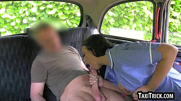 Hot brunette babe sucking a hard cock in a taxi